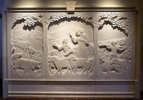 St. Vianney Triptych by Jill Burkee and Giancarlo Biagi (2019), marble, installed.