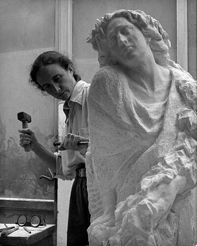 "Jill Burkee carving her Carrara marble sculpture ""Fall""."