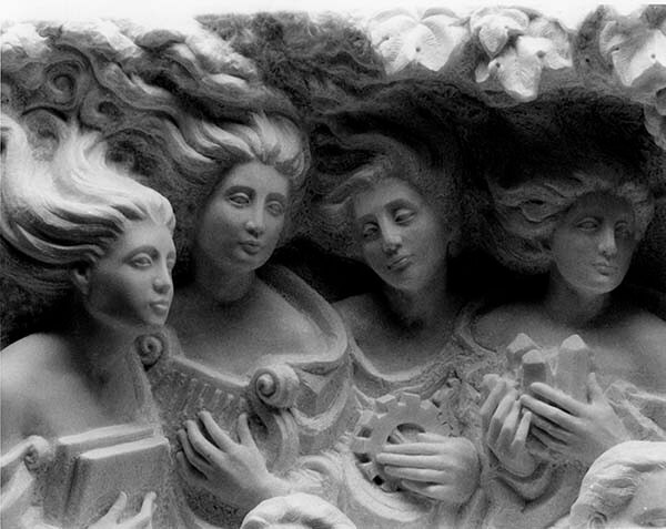 Four (4) muses in white Carrara marble