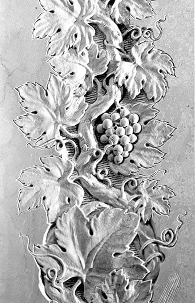 Low relief sculpture of grape vines in Travertino marble in the Mother of Africa Chapel at the Cathedral of the Immaculate Conception in Washington, DC