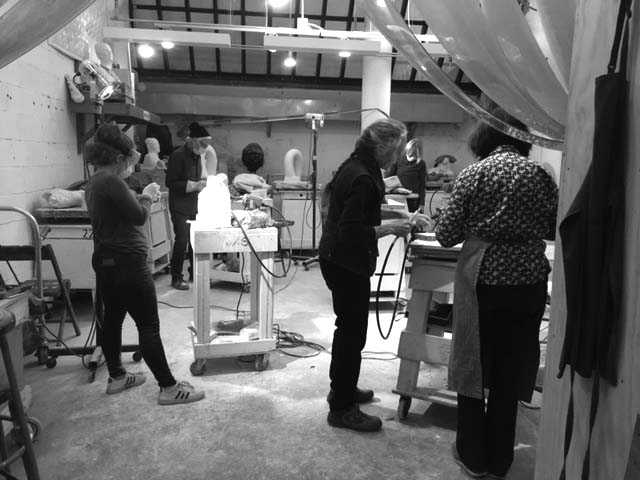 Master carver, Jill Burkee teaching marble sculpture at the Art Students League, NY