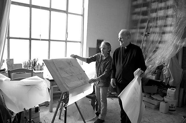 Father Paul Henry in Jill Burkee's studio.