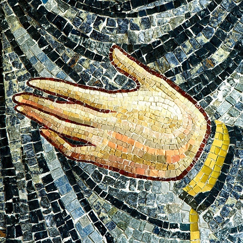 Hand detail of Mary mosaic detail from lunette above bronze portal.