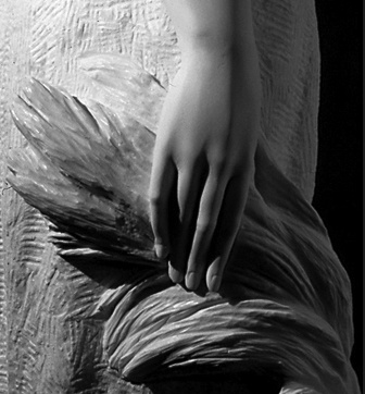 Hand closeup (detail) in Summer sculpture in white Carrara marble.