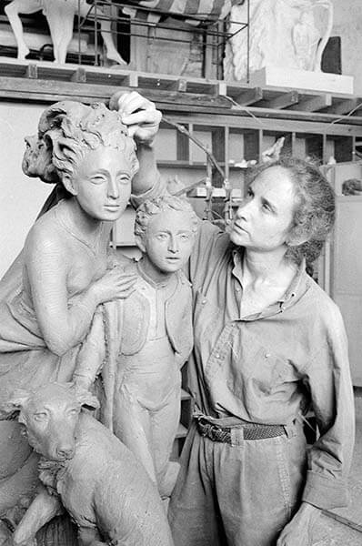"""Jill Burkee modeling her clay sculpture """"On Spanish Steps""""."""